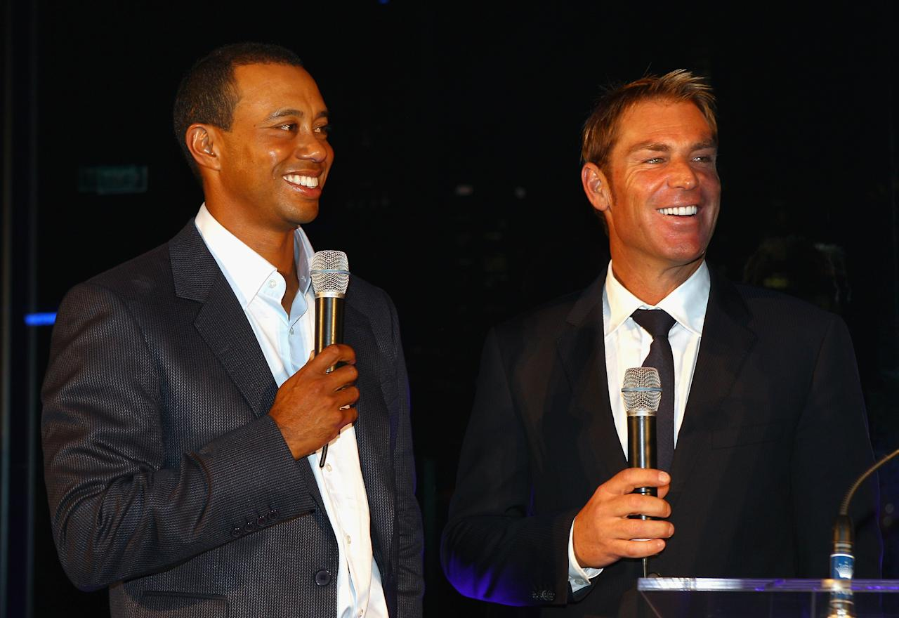 MELBOURNE, AUSTRALIA - NOVEMBER 07:  Tiger Woods and Shane Warne speak at the official opening of 'Club 23' at the Crown Entertainment Complex on November 7, 2011 in Melbourne, Australia.  (Photo by Mark Dadswell/Getty Images)