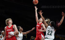 Japan's Moeko Nagaoka (0), second right, shoots over Nigeria's Oderah Chidom (22), right, during women's basketball preliminary round game at the 2020 Summer Olympics, Monday, Aug. 2, 2021, in Saitama, Japan. (AP Photo/Charlie Neibergall)