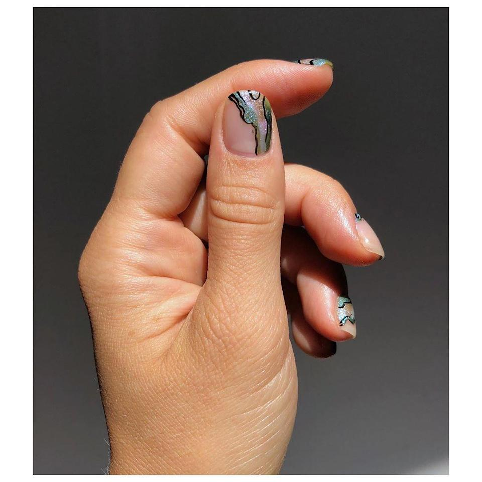 "This shell-inspired nail art is simply stunning. Try your hand at re-creating it with <a href=""https://shop-links.co/1716911719815190164"" rel=""nofollow noopener"" target=""_blank"" data-ylk=""slk:Essie's Let it Ripple collection"" class=""link rapid-noclick-resp"">Essie's Let it Ripple collection</a>."