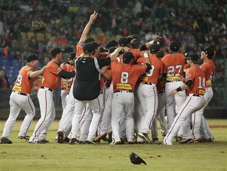 Australia's Canberra Cavalry players celebrate after defeating Taiwan's Uni-President 7-Eleven Lions during their Asia Series 2013 baseball game final at Taichung