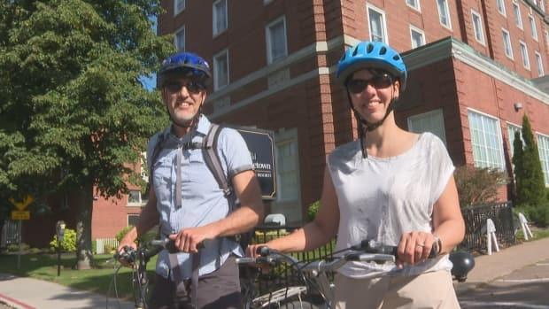 Harnys and Christine Chartier decided on a cycling tour of the Maritimes this fall rather than a vacation in Western Canada. (Laura Meader/CBC - image credit)