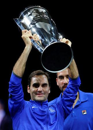 Tennis - Laver Cup - 3rd Day - Prague, Czech Republic - September 24, 2017 - Roger Federer of team Europe lifts the trophy after winning the tournament.   REUTERS/David W Cerny