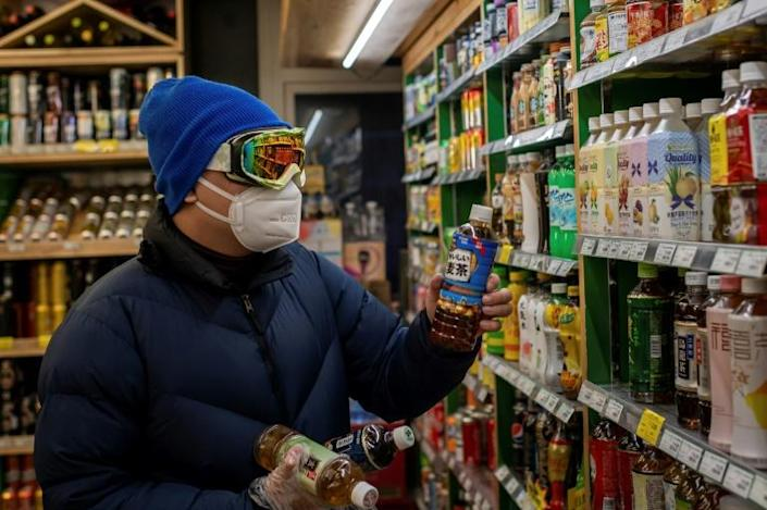 Businesses in Beijing are under pressure to prevent new infections (AFP Photo/NICOLAS ASFOURI)