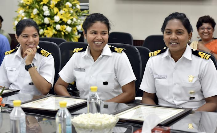 NEW DELHI, INDIA - MAY 24: Lieutenant Commander Pratibha Jamwal (L), Lieutenant Payal Gupta (C), Lieutenant Commander Patarlapalli Swathi (R) share a light moment after receiving Nari Shakti Puraskar at Shastri Bhawan on May 24, 2018 in New Delhi, India. Six women officers of the Indian Navy successfully circumnavigated the globe on Indian Naval Sailing Vessel Tarini in a first-ever Indian all women-crew expedition known as the Navika Sagar Parikrama. (Photo by Sonu Mehta/Hindustan Times via Getty Images)