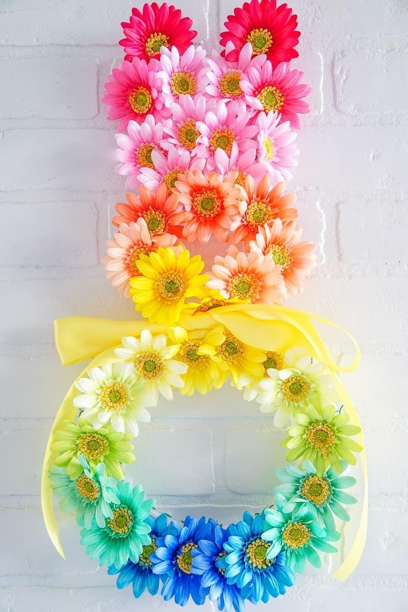"""<p>When it comes to Easter, the more color, the better! That's especially true of this flower-covered rainbow bunny wreath that's brimming with Easter joy. </p><p><strong>Get the tutorial at <a href=""""https://www.madewithhappy.com/easter-bunny-wreath-8/"""" rel=""""nofollow noopener"""" target=""""_blank"""" data-ylk=""""slk:Made with Happy"""" class=""""link rapid-noclick-resp"""">Made with Happy</a>.</strong></p><p><a class=""""link rapid-noclick-resp"""" href=""""https://go.redirectingat.com?id=74968X1596630&url=https%3A%2F%2Fwww.walmart.com%2Fip%2FOffray-1-5-x-12-Maize-Grosgrain-Ribbon-1-Each%2F46554500&sref=https%3A%2F%2Fwww.thepioneerwoman.com%2Fhome-lifestyle%2Fcrafts-diy%2Fg35698457%2Fdiy-easter-wreath-ideas%2F"""" rel=""""nofollow noopener"""" target=""""_blank"""" data-ylk=""""slk:SHOP RIBBON"""">SHOP RIBBON</a></p>"""