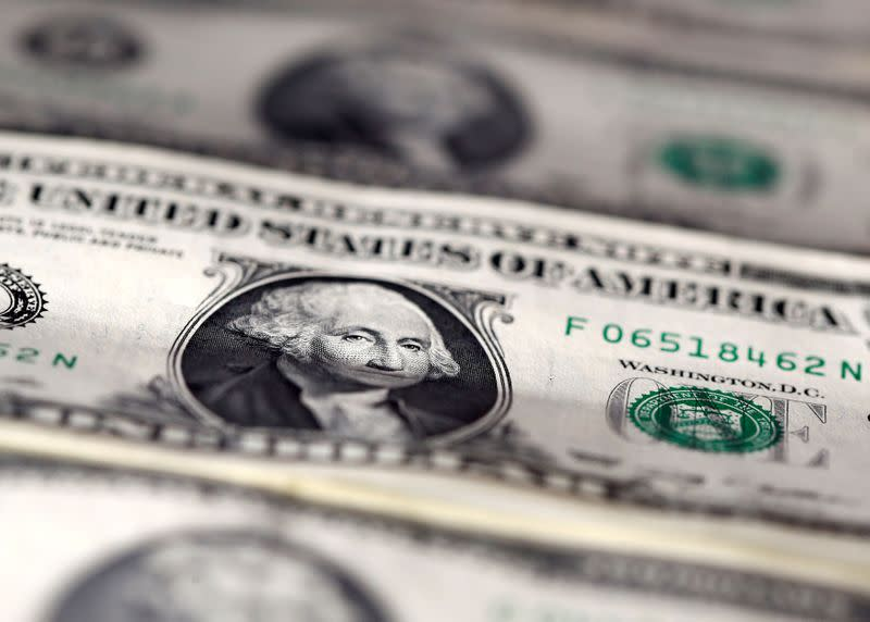 FILE PHOTO: FILE PHOTO: U.S. dollar notes are seen in this picture illustration