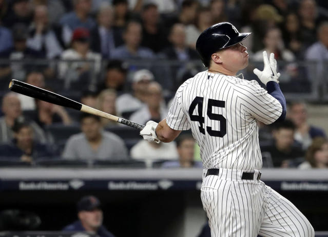 New York Yankees' Luke Voit watches his two-run home run off Boston Red Sox starting pitcher Eduardo Rodriguez during the second inning of a baseball game Thursday, Sept. 20, 2018, in New York. (AP Photo/Julio Cortez)