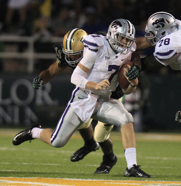 Kansas State quarterback Collin Klein (7) runs on the keeper as teammate offensive linesman Cornelius Lucas (78) tries to block Baylor defensive end Terrance Lloyd (11)during the first half of an NCAA college football game Saturday, Nov. 17, 2012, in Waco Texas. (AP Photo/LM Otero)
