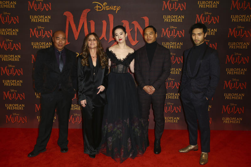 Actors, from left to right, Ron Yuan, Director Niki Caro, Yifei Liu, Jason Scott Lee and Yoson An, pose for photographers upon arrival at the European Premiere of 'Mulan' at a central London cinema, Thursday, March 12, 2020. (Photo by Joel C Ryan/Invision/AP)