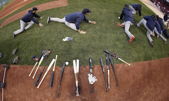 In this image taken with a fisheye lens, Detroit Tigers stretch out during a baseball workout at Fenway Park in Boston, Friday, Oct. 11, 2013. The Tigers face the Boston Red Sox in Game 1 of the American League championship series on Saturday. (AP Photo/Charlie Riedel)