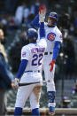 Chicago Cubs Javier Baez, right, celebrates with teammate Jason Heyward, left, after hitting a three-run home run during the third inning of a baseball game against the Atlanta Braves Saturday, April 17, 2021, in Chicago. (AP Photo/Paul Beaty)