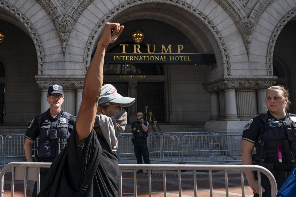 WASHINGTON, DC - JUNE 03: Demonstrators peacefully protest outside of Trump International Hotel Washington on Pennsylvania Avenue on June 3, 2020 in Washington, DC. Protests in cities throughout the country continue in the wake of the death of George Floyd, a black man who died while in police custody in Minneapolis on May 25. (Photo by Drew Angerer/Getty Images)