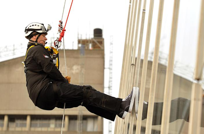 Prince Andrew abseiling down the Shard building to raise money for the Outward Bound Trust and the Royal Marines Charitable Trust Fund in 2012. (Reuters)