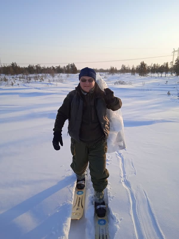 A researcher carries snow samples collected to investigate microplastic pollution levels in Yamalo-Nenets Autonomous Region