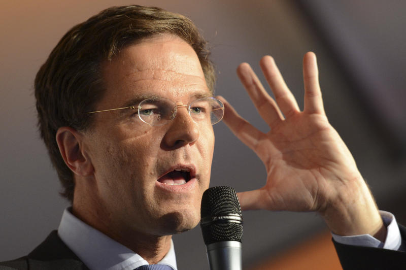 Dutch prime minister and Liberal Party leader Mark Rutte addresses supporters after exit poll results for the parliamentary elections were announced in The Hague, Netherlands, Wednesday Sept. 12, 2012.  An exit poll commissioned by the two biggest Dutch news broadcasters has predicted a narrow election victory for the Prime Minister Mark Rutte's free-market VVD party. The exit poll, which will be updated with late votes, gave the VVD 41 of the House of Representatives' 150 seats and the center-left Labor Party 40 votes. The poll has a 1.5 percent margin of error, and the broadcasters said the final result was still too close to call. (AP Photo/Ermindo Armino)