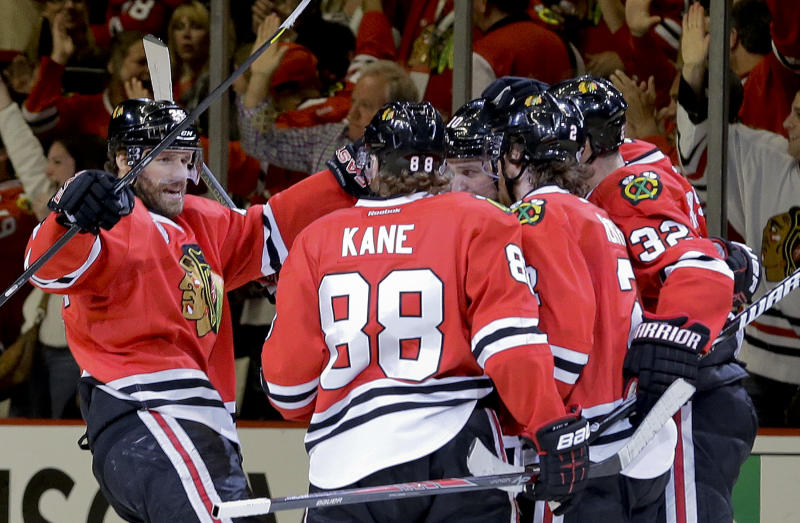 The Chicago Blackhawks celebrate a goal scored by Chicago Blackhawks center Patrick Sharp (10) against the Boston Bruins during Game 2 of the NHL hockey Stanley Cup Finals, Saturday, June 15, 2013, in Chicago. (AP Photo/Nam Y. Huh)