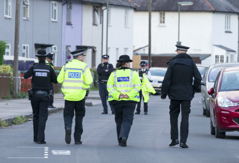 Police closed off an area of Sunbury-on-Thames to search the couple's home (Picture: Rex)