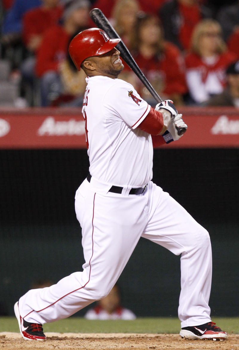 Los Angeles Angels' Vernon Wells swings at a pitch against the Chicago White Sox during the fourth inning of a baseball game in Anaheim, Calif., Monday, May 9, 2011. Wells left the game with an injury after the at-bat. (AP Photo/Chris Carlson)