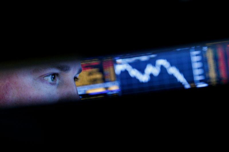 A specialist trader works at his post on the floor of the NYSE in New York