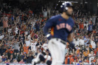 Fans cheer as Houston Astros' Abraham Toro rounds the bases after hitting a two-run home run during the fifth inning of a baseball game against the Texas Rangers, Sunday, July 25, 2021, in Houston. (AP Photo/Eric Christian Smith)