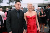 "Pink and Carey Hart have been married for a lifetime by Hollywood standards. They've been together for over a decade and it all started with Pink's proposal in 2005. Hart is a motocross pro, so Pink held up a sign at one of his events with the words ""will you marry me?"" on it. Cute. (Getty Images)"