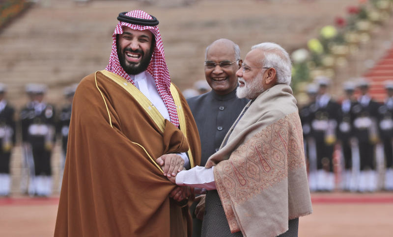 FILE - In this Feb. 20, 2019 file photo, Saudi Arabia's Crown Prince Mohammed bin Salman shakes hand with Indian Prime Minister Narendra Modi during a ceremonial welcome in New Delhi, India. Amid the Kashmir crisis, Gulf Arab states balance relations with Muslim-majority Pakistan and trade partner India. Saudi Arabia's response to the Kashmir situation is complicated by its close ties with both India and Pakistan, which have fought two wars over the disputed Himalayan region, as well as its ideological rivalry with Turkey and Iran for supremacy in the Islamic world. (AP Photo/Manish Swarup, File)
