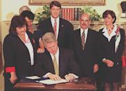 <p>Pelosi watches as President Bill Clinton signs the Ryan White Comprehensive AIDS Resources Emergency Act Amendments of 1996.</p>