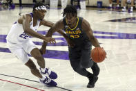 File-TCU guard RJ Nembhard (22) defends as Baylor guard Davion Mitchell (45) drives the ball past during a men's NCAA college basketball game, Saturday, Jan. 9, 2021. Mitchell and MaCio Teague, two of the league's best shooters, were part of a Big 12-record 23-game winning streak last season in their debuts as Baylor starters. Those former transfers had also gone through a redshirt season together. (AP Photo/ Richard W. Rodriguez, File)