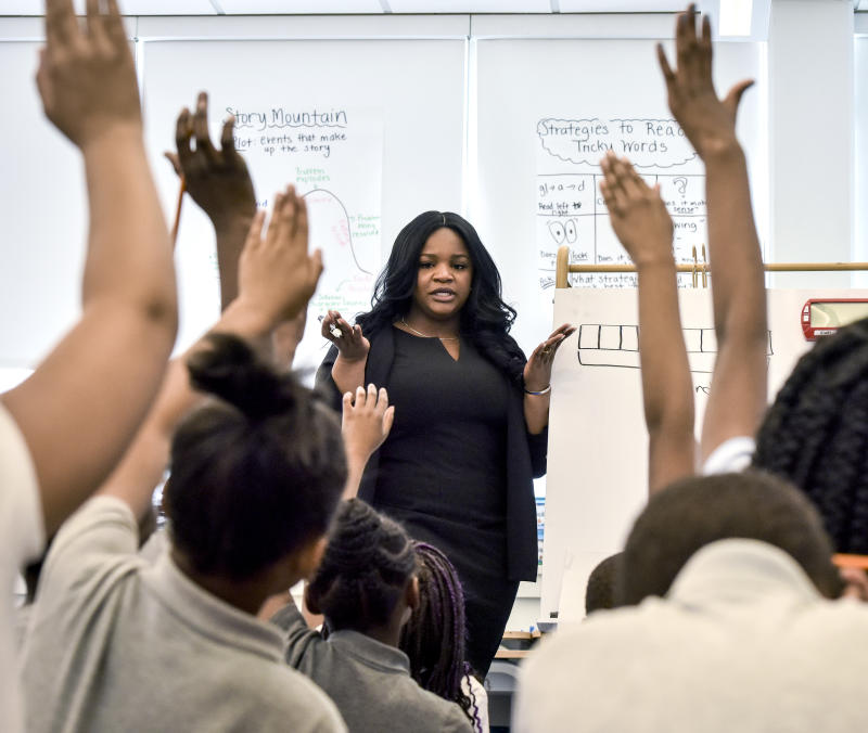 WASHINGTON, DC - APRIL 11: Kelly Harper, center, one of four finalists for the National Teacher of the Year, in her 3rd grade classroom at Amidon-Bowen elementary school, on April, 11, 2019 in Washington, DC. (Photo by Bill O'Leary/The Washington Post via Getty Images)