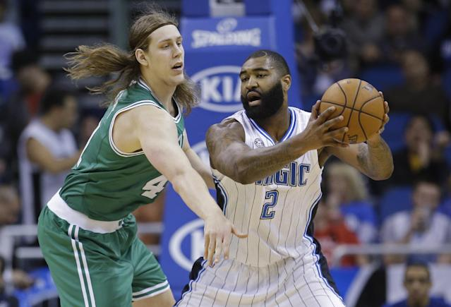 Boston Celtics' Kelly Olynyk, left, tries to get the ball from Orlando Magic's Kyle O'Quinn (2) during the first half of an NBA basketball game in Orlando, Fla., Sunday, Jan. 19, 2014. (AP Photo/John Raoux)