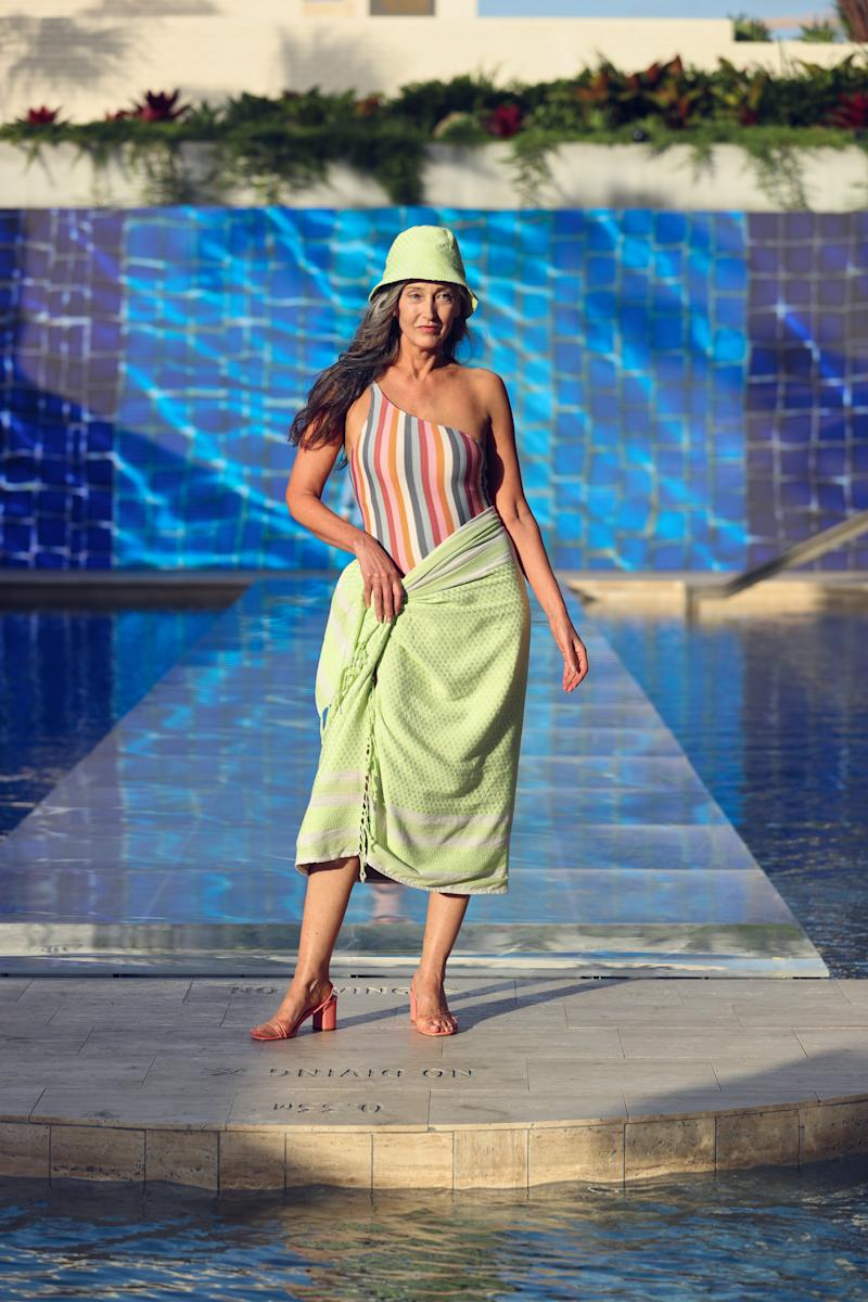 A model wears the Peony One-Shoulder One-Piece, $219.00 from THE ICONIC Summer Show '19