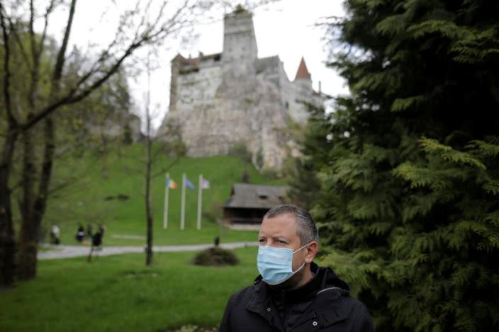Alexandru Priscu, Bran Castle's marketing director, looks on during interview with Reuters reporter
