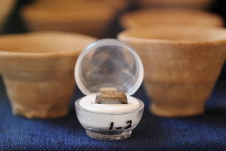A silver ring is displayed during the presentation of a new discovery in the Monkey Valley near the Valley of the Kings in Luxor