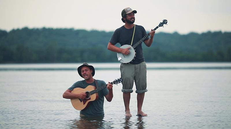 In this June 2011 photo provided courtesy of Alex Johnson, the Okee Dokee Brothers, Joe Mailander, left, and Justin Lansing are shown on the Mississippi River. The Minneapolis duo has been nominated for a Grammy Award for best children's album. (AP Photo/Courtesy of Alex Johnson)
