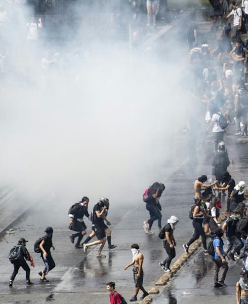 Fueled by outrage at Pinera and the elite that controls most of the country's wealth, Chile has seen its worst social unrest since the transition to democracy from the military dictatorship in 1990 (AFP Photo/Martin BERNETTI)