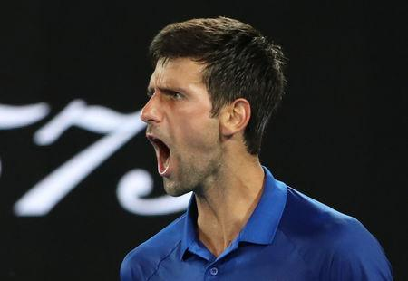 Tennis - Australian Open - First Round - Melbourne Park, Melbourne, Australia, January 15, 2019. Serbia's Novak Djokovic reacts during the match against Mitchell Krueger of the U.S. REUTERS/Lucy Nicholson