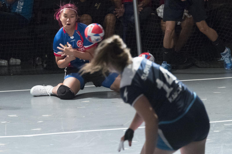 A Hong Kong player is hit by the ball during women's competition against Slovenia in the Dodgeball World Cup, Saturday, Aug. 4, 2018, in New York. (AP Photo/Mary Altaffer)