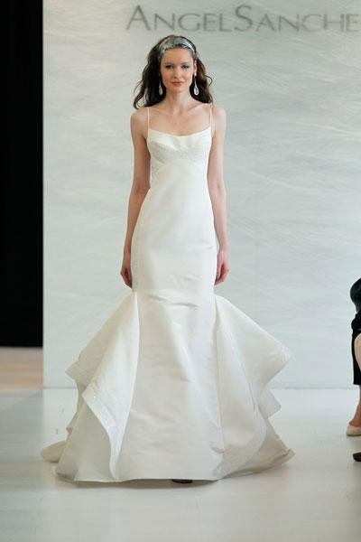 """<div class=""""caption-credit""""> Photo by: Angel Sanchez</div><div class=""""caption-title"""">9. Angel Sanchez</div>This clean, architectural masterpiece by Angel Sanchez is perfect for the modern-chic bride. We love the subtle hint of sparkle on the bodice and hem of the skirt. The dainty spaghetti straps are absolutely darling. <br> <br> Check out more gorgeous styles in our <a rel=""""nofollow noopener"""" href=""""http://www.bridalguide.com/photo-galleries/bridal-gowns/angel-sanchez/style-n100"""" target=""""_blank"""" data-ylk=""""slk:Angel Sanchez gown gallery"""" class=""""link rapid-noclick-resp"""">Angel Sanchez gown gallery</a>!"""