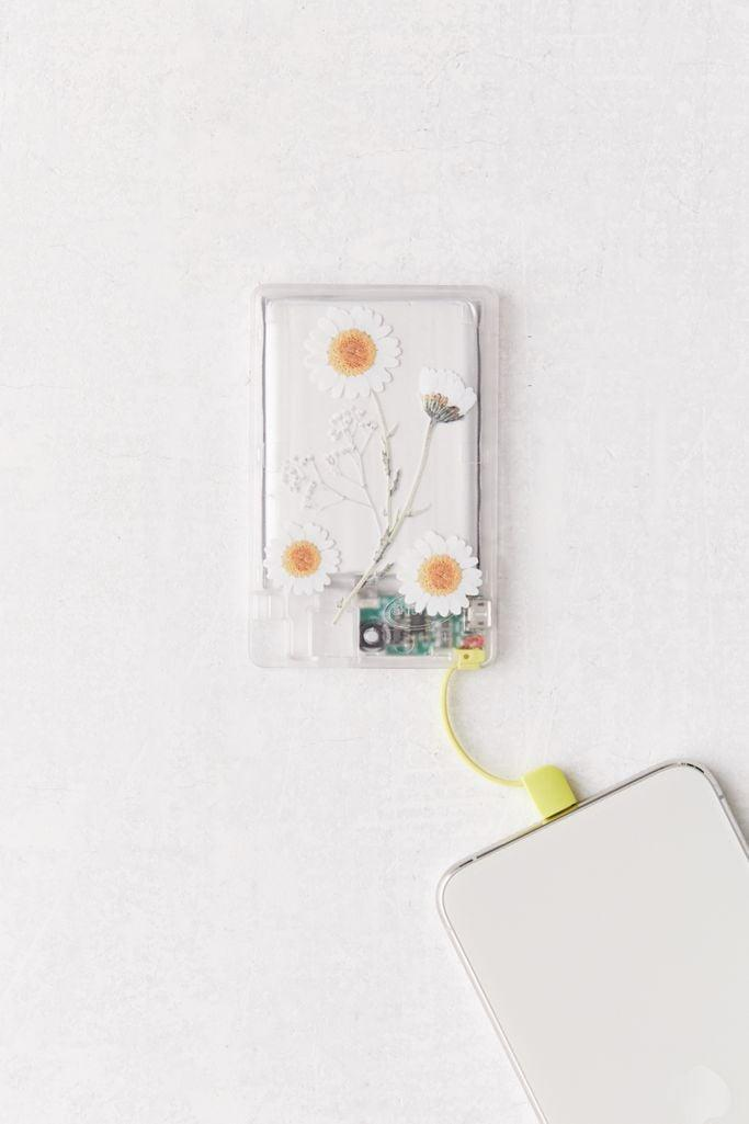 <p>They'll never - god forbid - run out of phone juice thanks to this <span>Daisy Print Clear Tech Portable Power Bank</span> ($25).</p>