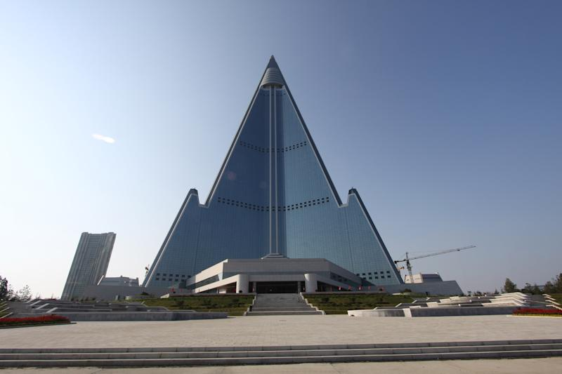 In this Sept. 23, 2012 photo released by Koryo Group on Wednesday, Sept. 26, 2012, the pyramid-shaped, 105-story Ryugyong Hotel stands in Pyongyang, North Korea. A foreign tour agency said the interior of the massive, hotel in the North Korea capital remains unfinished. Beijing-based Koryo Tours got a sneak peek inside the hotel that has been an off-limits construction site and remains a source of fascination for the outside world. (AP Photo/Koryo Group) NO SALES EDITORIAL USE ONLY
