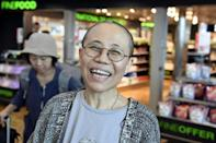 Liu Xia, the widow of Chinese Nobel dissident Liu Xiaobo, smiles as she arrives at the Helsinki International Airport in Vantaa, Finland