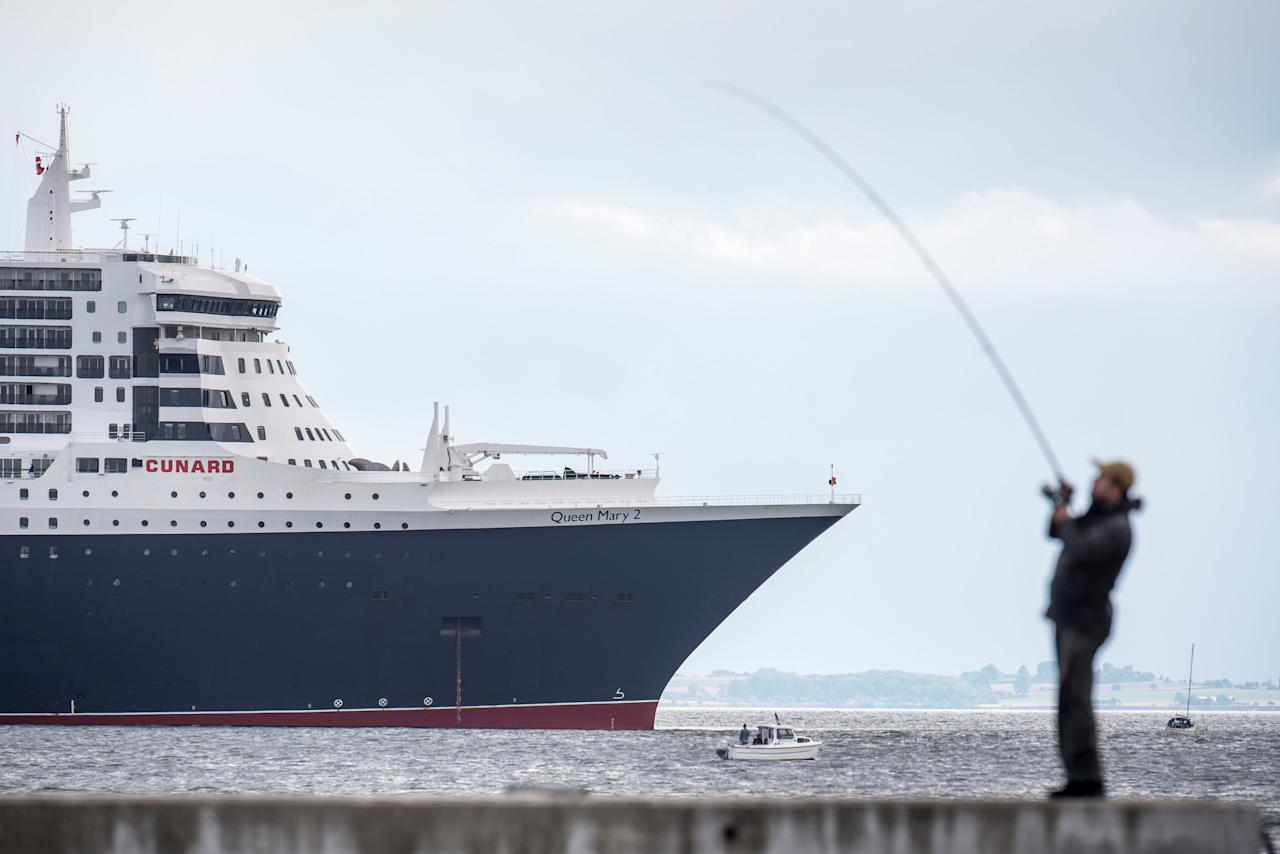 Queen Mary 2 cruise ship is anchored near to Kronborg Castle in Elsinore, Denmark, August 14, 2018. Mads Claus Rasmussen/Ritzau Scanpix/via REUTERS    ATTENTION EDITORS - THIS IMAGE WAS PROVIDED BY A THIRD PARTY. DENMARK OUT. NO COMMERCIAL OR EDITORIAL SALES IN DENMARK.