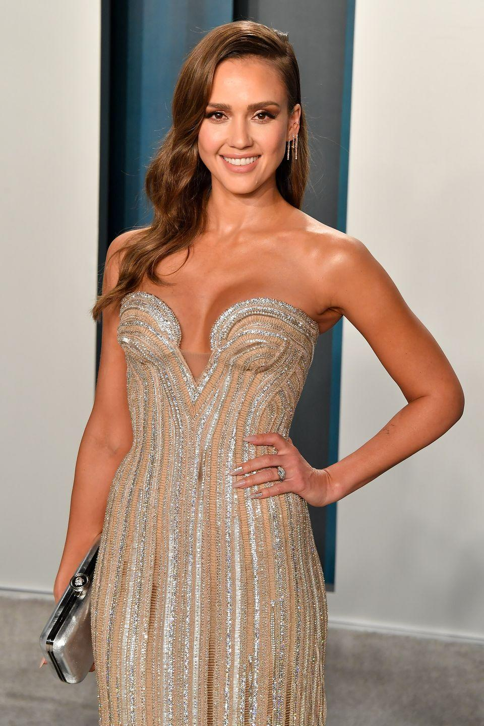"""<p>Staying fit in lockdown, Jessica Alba has been training with fitness coach Aaron Hines, <a href=""""https://www.youtube.com/watch?v=se3hE_aIgmg&ab_channel=JessicaAlba"""" rel=""""nofollow noopener"""" target=""""_blank"""" data-ylk=""""slk:sharing their workouts to her 182k subscribers on YouTube"""" class=""""link rapid-noclick-resp"""">sharing their workouts to her 182k subscribers on YouTube</a>. Featuring reverse lunge hops, mountain climbers and resistance band lower-body moves, it's a sweaty session you can follow along, too. </p>"""