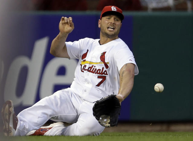 St. Louis Cardinals left fielder Matt Holliday cannot catch a ball hit by Arizona Diamondbacks' Tuffy Gosewisch for a single during the sixth inning of a baseball game Thursday, May 22, 2014, in St. Louis. (AP Photo/Jeff Roberson)