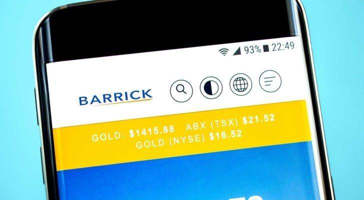 The Barrick Gold (GOLD) logo is displayed on a smartphone screen over a bright blue background.