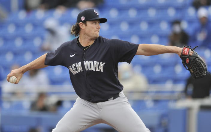 New York Yankees starter Gerrit Cole pitches against the Toronto Blue Jays during the third inning of a spring training baseball game Sunday, March 21, 2021, at TD Ballpark in Dunedin, Fla. (Steve Nesius/The Canadian Press via AP)