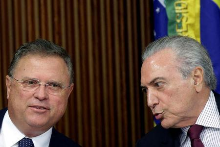 Brazil's Agriculture Minister Blairo Maggi speaks with Brazil's President Michel Temer during a meeting with ambassadors of meat importing countries of Brazil at the Planalto Palace in Brasilia, Brazil March 19, 2017. REUTERS/Ueslei Marcelino