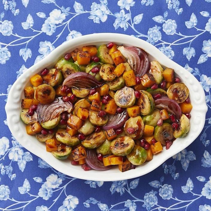 """<p>This gorgeous pile of roasted seasonal vegetables is guaranteed to shine on your Christmas table. Sprinkle the platter with pomegranate seeds for an extra pop of color. </p><p><a href=""""https://www.thepioneerwoman.com/food-cooking/recipes/a80688/beautiful-brussels-sprouts/"""" rel=""""nofollow noopener"""" target=""""_blank"""" data-ylk=""""slk:Get Ree's recipe."""" class=""""link rapid-noclick-resp""""><strong>Get Ree's recipe. </strong></a></p><p><a class=""""link rapid-noclick-resp"""" href=""""https://go.redirectingat.com?id=74968X1596630&url=https%3A%2F%2Fwww.walmart.com%2Fsearch%3Fq%3Dpioneer%2Bwoman%2Bplatter&sref=https%3A%2F%2Fwww.thepioneerwoman.com%2Ffood-cooking%2Fmeals-menus%2Fg37723446%2Fchristmas-side-dishes%2F"""" rel=""""nofollow noopener"""" target=""""_blank"""" data-ylk=""""slk:SHOP PLATTERS"""">SHOP PLATTERS</a></p>"""