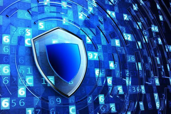 An illustrated blue shield over a wall of numbers, illustrating cybersecurity software.