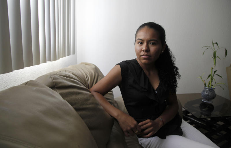 Araceli Cortes, an illegal immigrant who wants to go to medical school, is shown at her home in the Los Angeles-area suburb of Canyon Country, Calif., Tuesday, June 26, 2012. Cortes had made up her mind to return to Mexico to pursue her dream of becoming a doctor. She quit her job, purchased an airline ticket and reserved a seat to take a medical school entrance exam. Then, a week before her departure, President Barack Obama announced that young illegal immigrants like Cortes would be given the chance to remain in the United States and obtain a work visa. Cortes canceled her ticket and decided to stay. But she's still having second thoughts. (AP Photo/Reed Saxon)